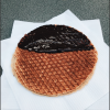 Freshly made stroopwafel - this is a famous dessert in Amsterdam