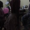 A neighborhood girl shows us a popular dance!