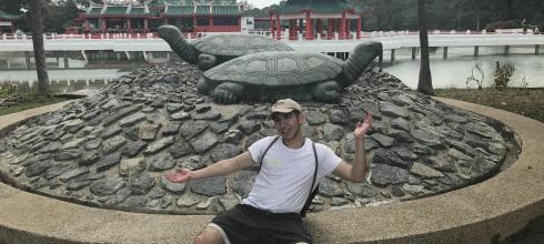 Here I am next to a statue of tortoises.