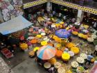 The crowded markets of the city contrast with...