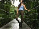 Standing on a bridge over a river in the forest, enamored by the beauty of Costa Rica