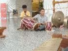 Me playing the tapak, kendong and tom with my hands and feet during Sundanese gamelan class