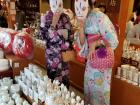 """My sister and I pose with """"kitsune"""" (fox) masks at the Fushimi Inari Shrine; kitsune is the """"kami"""" (deity) of Inari Shinto shrines"""