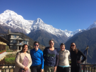 Our group is standing with the sacred mountain callled Annapurna Dakshin behind us on one of the rare clear days of our trip