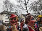 Satirical figures in the parade