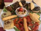 An appetizer tray of Nicoise (neese-waas) specialties (traditional food from the region)