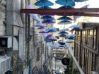 A famous staircase in downtown Amman known for the colorful umbrellas and plants!